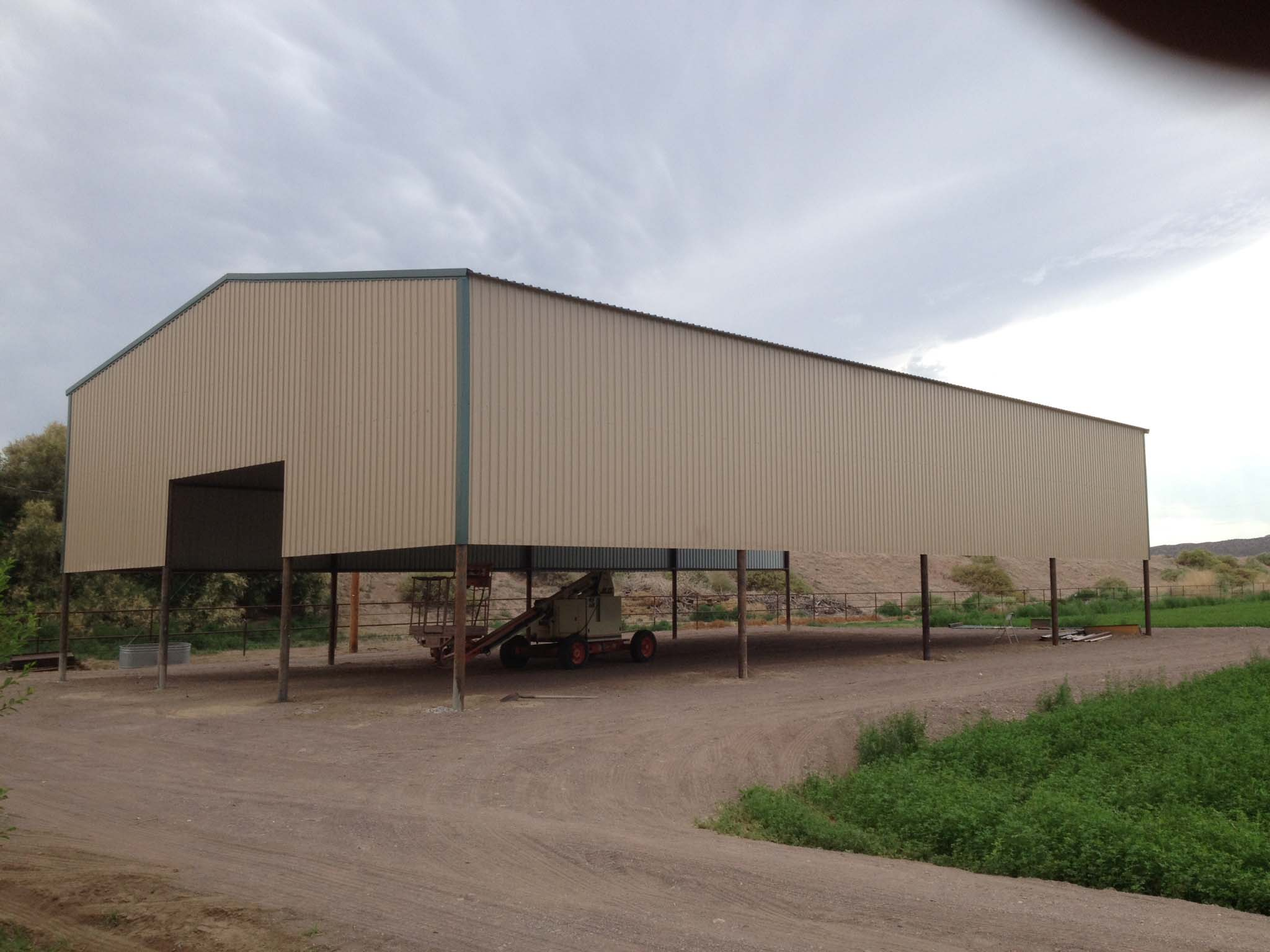 Pole barns neds pipe and steel for Two story steel building prices
